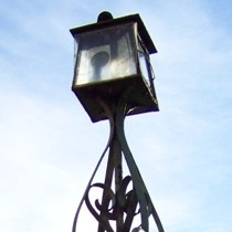 Gate pier with lamp